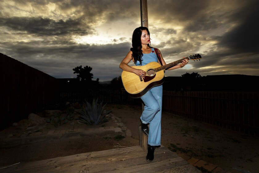 PIONEERTOWN, CA - APRIL 5, 2019: Country singer and songwriter Jade Jackson poses against a backdro