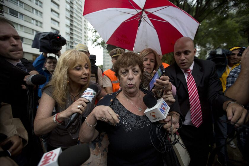 Prosecutor Viviana Fein on Monday talks to reporters outside the apartment where special prosecutor Alberto Nisman was found dead in Buenos Aires.