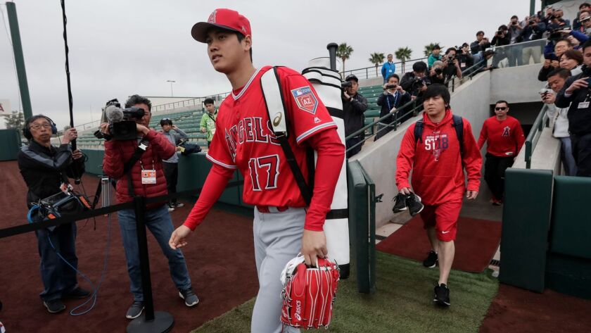 Shohei Ohtani experiences his first day of spring training camp along with other pitchers and catchers at Tempe Diablo Stadium on Feb. 14.