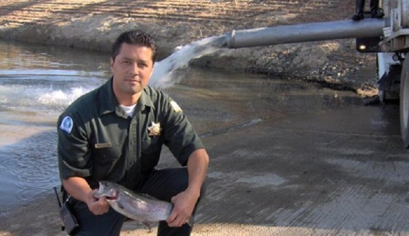Lake Jennings supervising ranger David Acevedo shows off trout that was part of stocking the lake received. A ruling Tuesday paved the way for future stockings and growing of fish.
