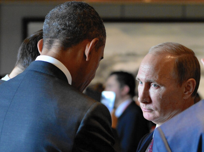 President Obama speaks with Russian President Vladimir Putin at the Asia-Pacific Economic Cooperation summit in Beijing on Nov. 11. Despite economic sanctions on Russia, Putin has shown no sign that he intends to reverse the Crimea annexation or ease support for Ukrainian rebels.