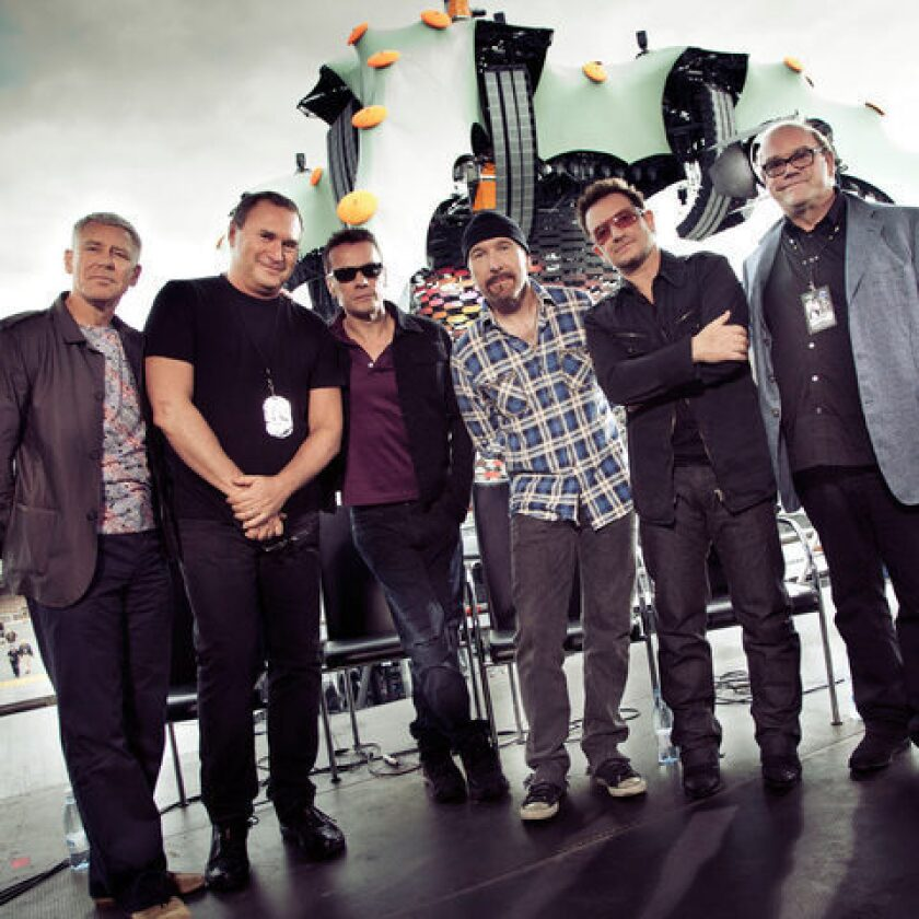 Paul McGuinness, right, with members of U2, the band he has managed for more than 30 years.