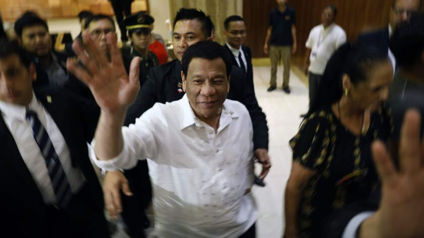 The president of the Philippines, Rodrigo Duterte, waves after arriving in Jerusalem.