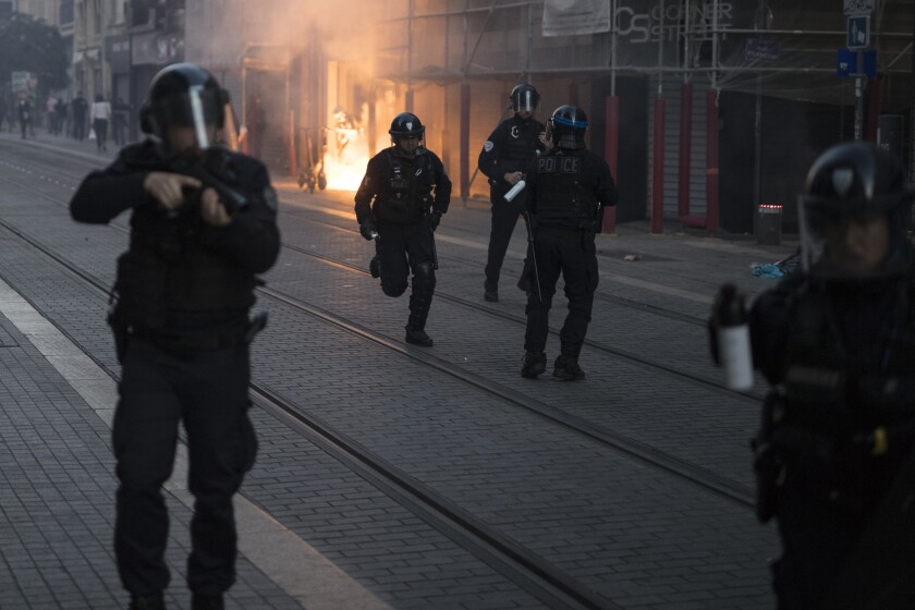 Police advance on protesters during a march against police brutality and racism Saturday in Marseille, France.