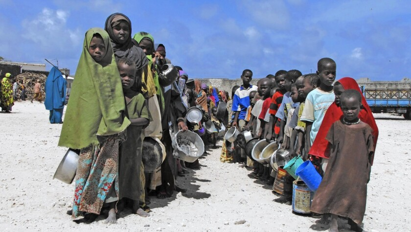 Somali-Americans said some relatives will be unable to afford food, clothing, rent or school fees if it becomes impossible to send money because of fears of illicit fund transfers to terrorists such as the Shabab, an Islamic militant group with ties to Al Qaeda. Above, children from southern Somalia hold their pots as they line up to receive cooked food in Mogadishu, Somalia, in 2011.
