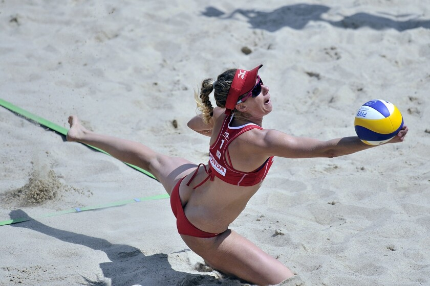 April Ross saves the ball during a FIVB semifinal match in Poland on July 6.