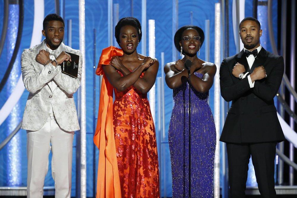 "Wakanda forever: ""Black Panther's"" Chadwick Boseman, from left, Danai Gurira, Lupita Nyong'o and Michael B. Jordan pay tribute at the 76th Golden Globe Awards."