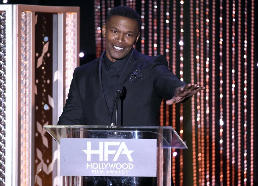 FILE - In this Nov. 1, 2015 file photo, Jamie Foxx presents the Hollywood actor award at the Hollywood Film Awards at the Beverly Hilton Hotel in Beverly Hills, Calif. Foxx has played super villains and antiheroes on screen. The role of super hero he apparently saved for real life. Foxx and the vic