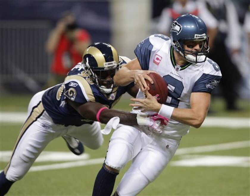 St. Louis Rams defensive end George Selvie (90) sacks Seattle Seahawks quarterback Matt Hasselbeck (8) during the second quarter of an NFL football game Sunday, Oct. 3, 2010, in St. Louis. (AP Photo/Tom Gannam)