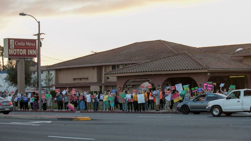 COSTA MESA, OCTOBER 22, 2015 - Affordable housing advocates protest in front of the Costa Mesa Motor