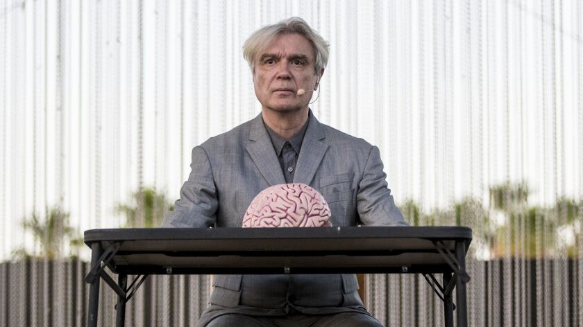 INDIO, CALIF. -- SATURDAY, APRIL 14, 2018: David Byrne on stage with a model brain at the Coachella