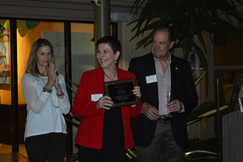 Ann Elise Ryder, Ruth Yansick and Glen Rasmussen celebrate Yansick's recognition as CEO of the La Jolla Community Center board.