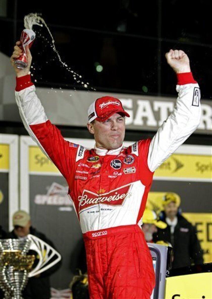 Kevin Harvick celebrates in Victory Lane after winning the NASCAR Sprint Unlimited auto race at Daytona International Speedway, Saturday, Feb. 16, 2013, in Daytona Beach, Fla. (AP Photo/Terry Renna)