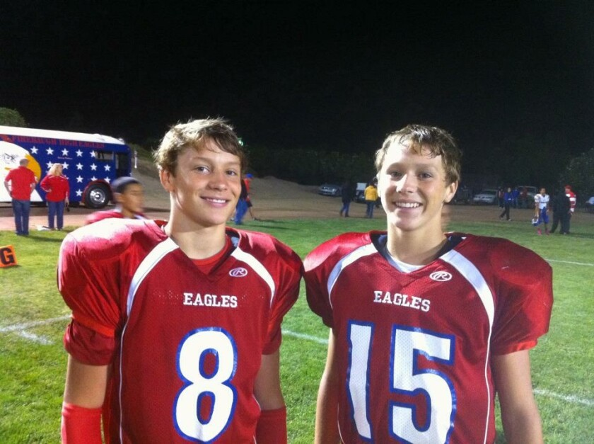 Josh Allen and his brother, Jason, in uniform on the football field at Firebaugh High School.