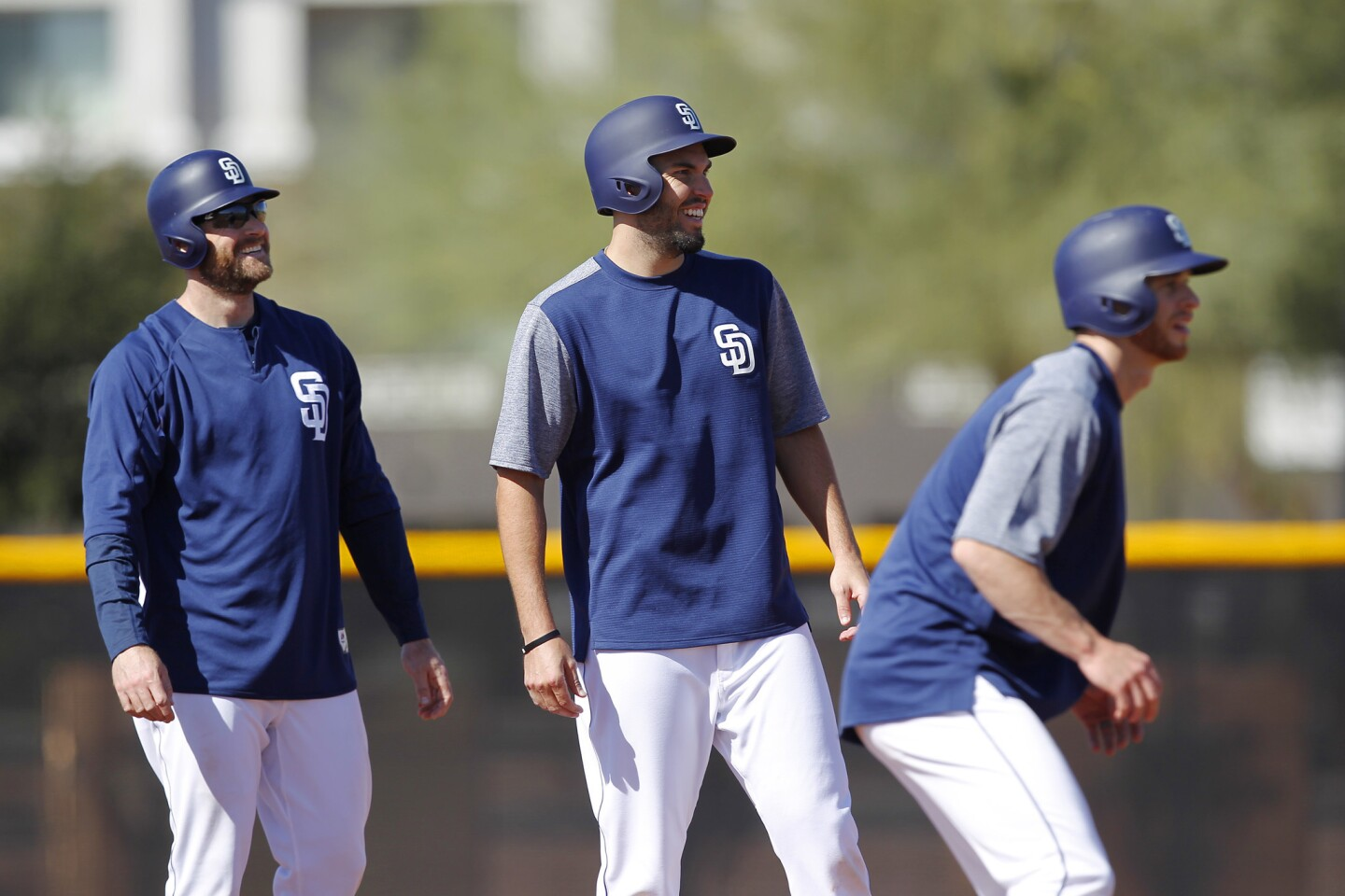 San Diego Padres first baseman Eric Hosmer, center, runs bases with Chase Headley, left, and Cory Spangenberg during a spring training practice in Peoria on Feb. 20, 2018. (Photo by K.C. Alfred/ San Diego Union -Tribune)