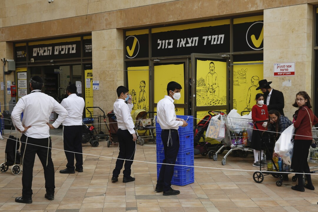 ISRAEL: Ultra-Orthodox Jews wait to enter a supermarket while keeping a safe social distance as part of the government's measures to stop the spread of the coronavirus in the Orthodox city of Bnei Brak, a Tel Aviv suburb, Israel.