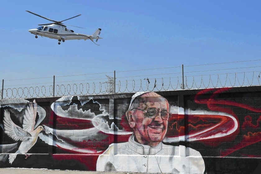 A mural welcomes Pope Francis to Ecatepec, outside Mexico City. The pope arrives in Mexico on Friday.