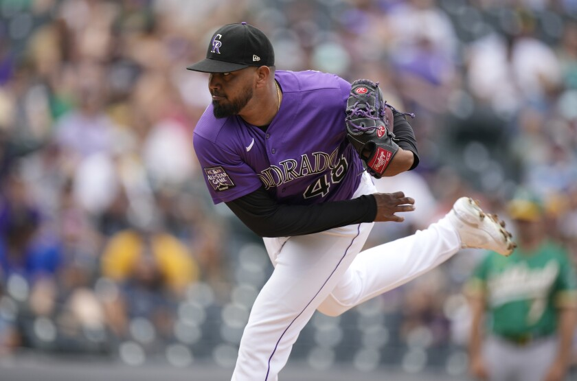 Colorado Rockies starting pitcher German Marquez works against the Oakland Athletics in the first inning of a baseball game Sunday, June 6, 2021, in Denver. (AP Photo/David Zalubowski)