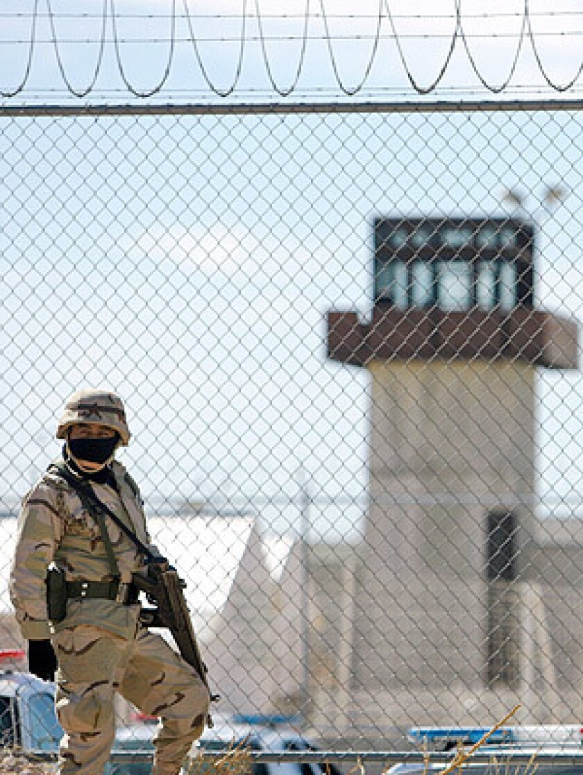 A soldier stands guard at the prison in Ciudad Juarez during the riot. The violence comes as the ravaged city is being placed under military control