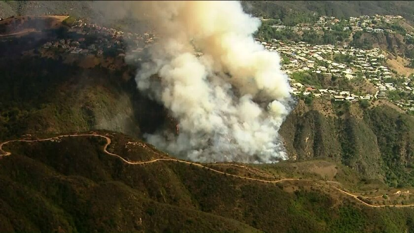 Evacuations are lifted after brush fire burns near Pacific Palisades homes