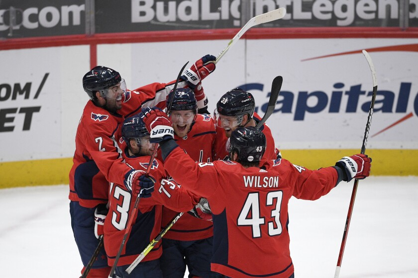 Washington Capitals center Lars Eller (20) celebrates his goal with right wing Tom Wilson (43), left wing Conor Sheary (73), defenseman Justin Schultz (2), and right wing Anthony Mantha (39) during the third period of an NHL hockey game against the Philadelphia Flyers, Saturday, May 8, 2021, in Washington. The Capitals won 2-1 in overtime. (AP Photo/Nick Wass)