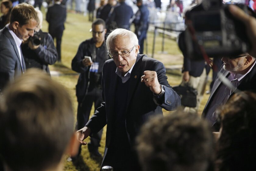 Sen. Bernie Sanders campaigns in North Las Vegas. He is seeking to boost his support among Latinos in the state, which holds one of the first contests of the nominating season.