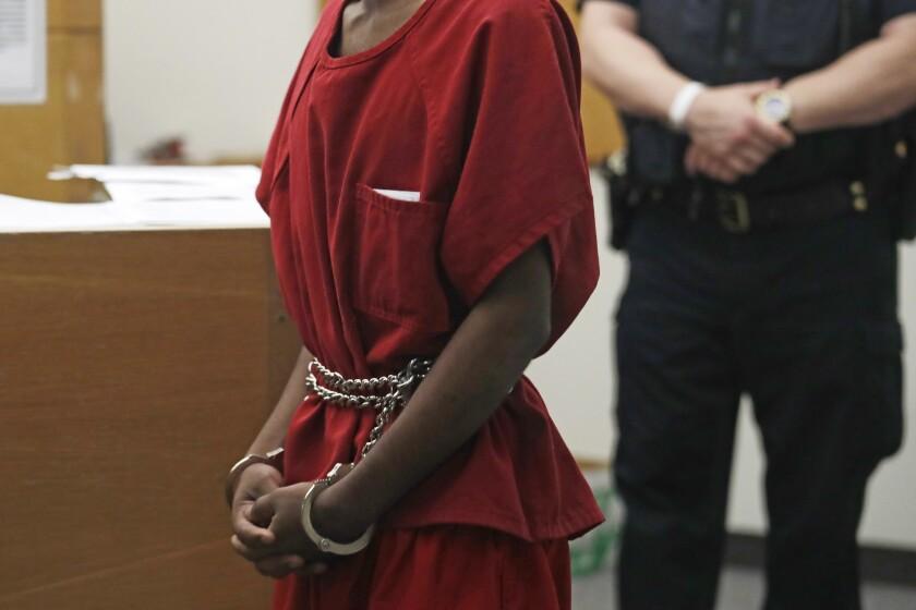 Dawit Kelete wears handcuffs