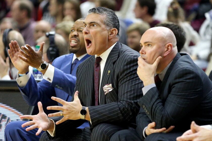 South Carolina head coach Frank Martin, center, reacts after a call during the first half of an NCAA college basketball game against Texas A&M, Saturday, Feb. 6, 2016, in College Station, Texas. (AP Photo/Sam Craft)