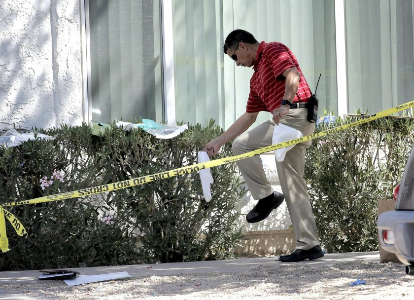 A Phoenix police detective exits  a home, Thursday, June 2, 2016 in Phoenix where three boys were killed during a several hour period Wednesday night.  The boy's mother was hospitalized in critical condition with self-inflicted stab wounds according to Phoenix police. (AP Photo/Matt York)