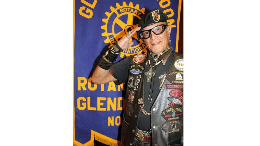 """Albert Lynn """"Lone Wolf"""" Boles smartly salutes the flag as he leads Glendale Noon Rotary members"""