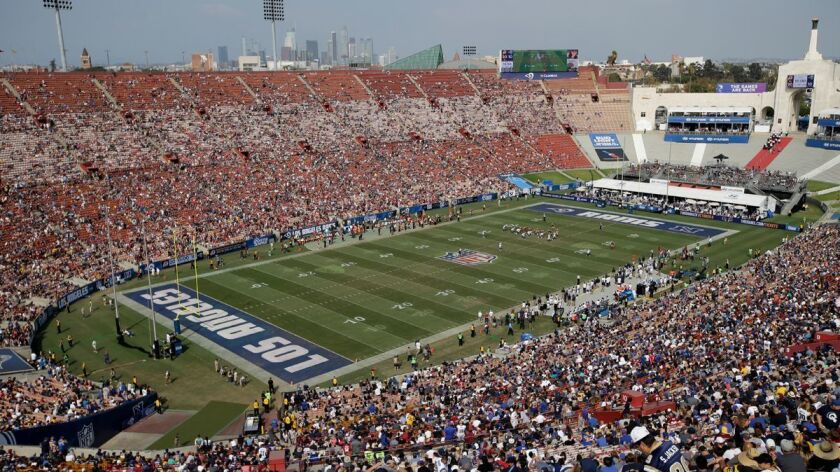 Fans watch in this general view of LA Memorial Coliseum during the second half of an NFL football ga