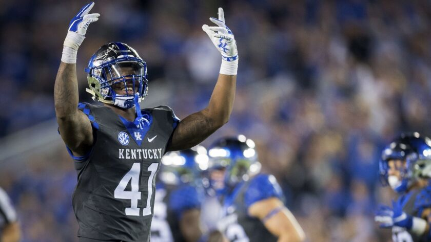 Kentucky linebacker Josh Allen (41) rallies fans during the second half of the team's game against South Carolina, in Lexington, Ky. Allen was named to the 2018 AP All-America NCAA college football team, Monday, Dec. 10, 2018.