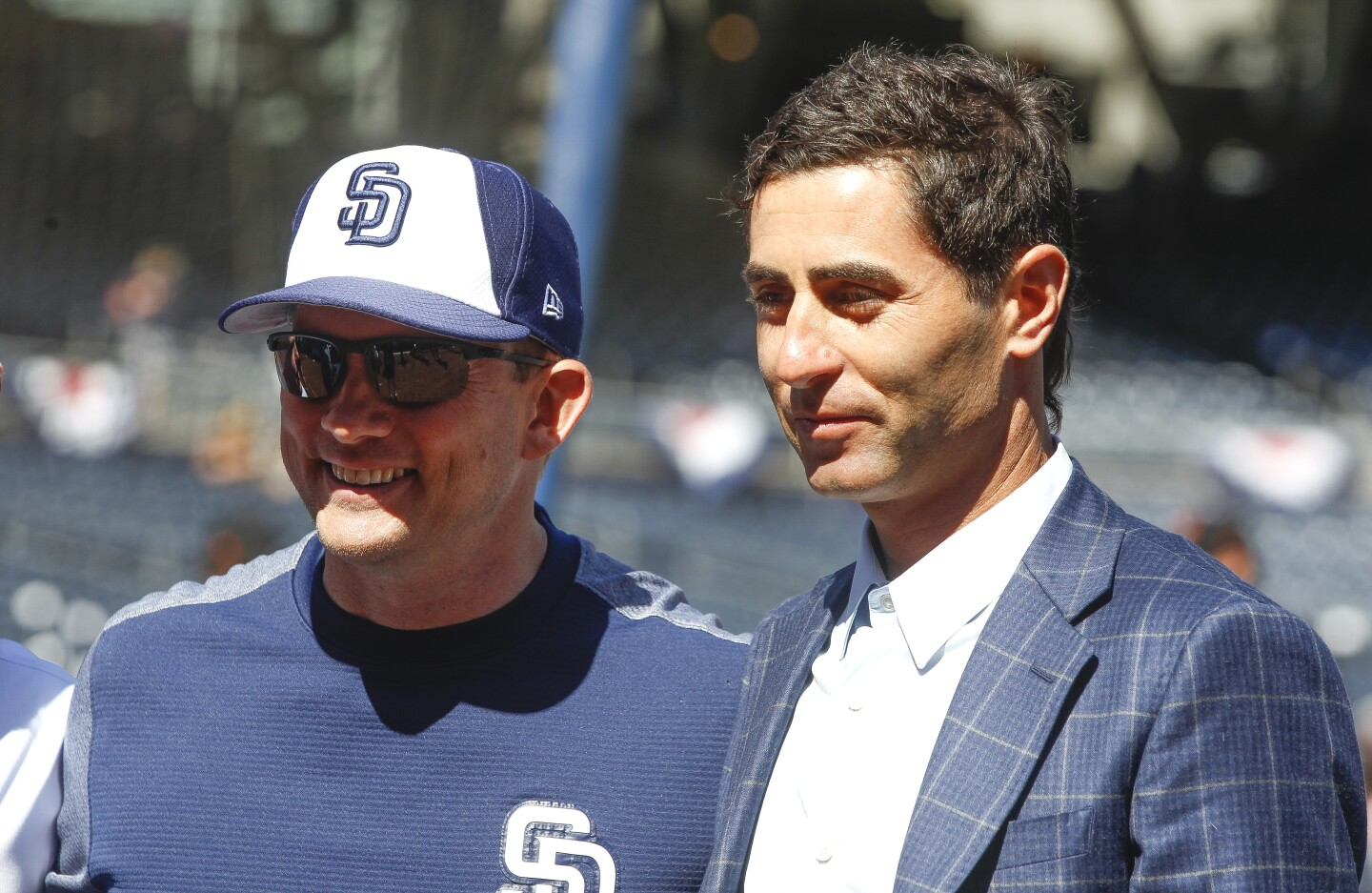 Padres manager Andy Green, left, and Padres general manager A.J. Preller before the start of the Padres' game against the Giants during the Padres home opener at Petco Park in San Diego on Thursday.