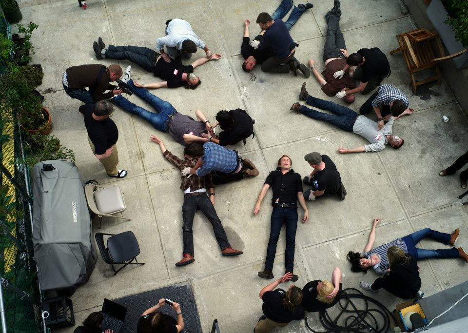 Participants practice first aid procedures on each other during the Reporters Instructed in Saving Colleagues, or RISC, hostile environment first aid program for freelance journalists at the Bronx Documentary Center in New York.