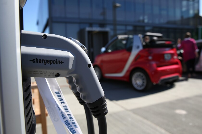 State regulators voted Thursday to allow installation of 7,500 vehicle charging stations in Northern California. Above, a ChargePoint electric vehicle charger in Century City.