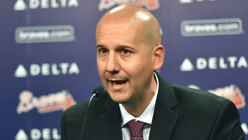 Former Atlanta Braves general manager John Coppolella, shown in 2015, was banned from baseball for life on Tuesday.