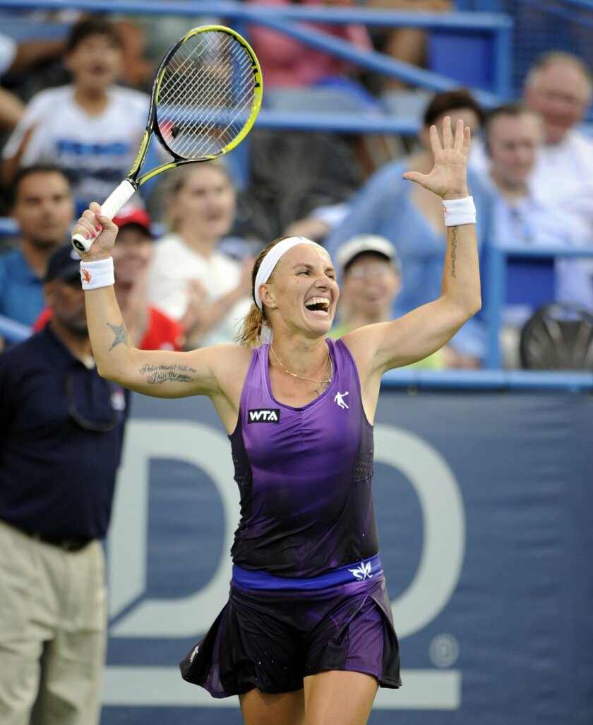Svetlana Kuznetsova, of Russia, celebrates after she beat Kurumi Nara, of Japan, in the women's final match at the Citi Open tennis tournament, Sunday, Aug. 3, 2014, in Washington. Kuznetsova won 6-3, 4-6, 6-4. (AP Photo/Nick Wass)