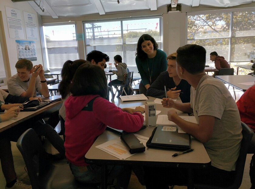 Summit teacher Maren Adler works with an AP English literature class on a project about visual rhetorical analysis.