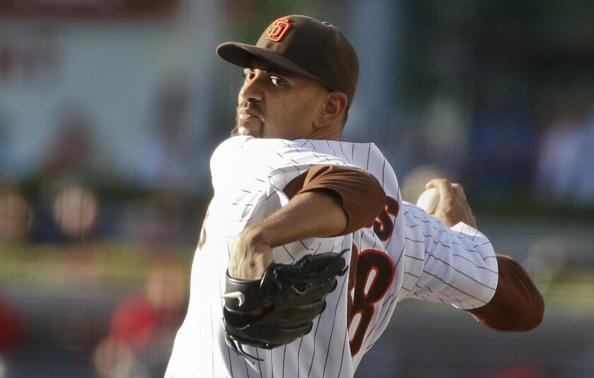 San Diego Padres starting pitcher Tyson Ross works against the Philadelphia Phillies during the first inning of a baseball game Saturday, Aug. 8, 2015, in San Diego. (AP Photo/Lenny Ignelzi)