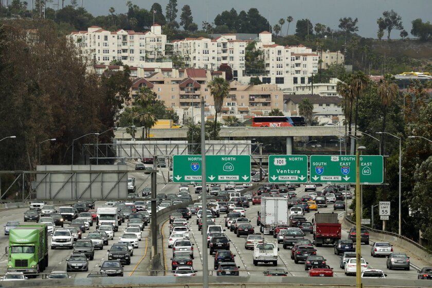 Traffic slowly moves along the 110 Freeway during afternoon rush hour in downtown Los Angeles on May 6, 2015.