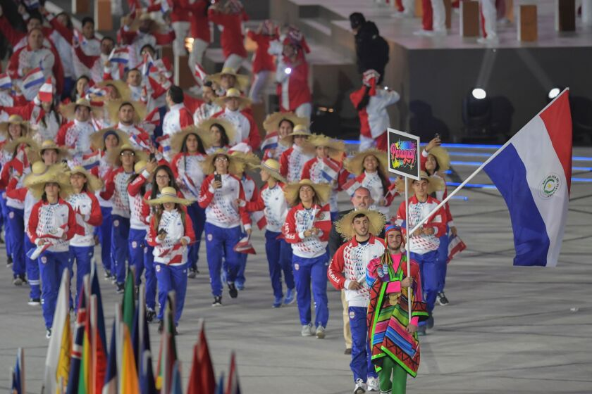 Paraguay's flag-bearer, table tennis player Alejandro Toranzos, leads his delegation during the Parade of Nations of the opening ceremony of the Lima 2019 Pan-American Games at the National Stadium in Lima, on July 26, 2019. - The Pan-American Games run until August 11. (Photo by Pedro PARDO / AFP)PEDRO PARDO/AFP/Getty Images ** OUTS - ELSENT, FPG, CM - OUTS * NM, PH, VA if sourced by CT, LA or MoD **