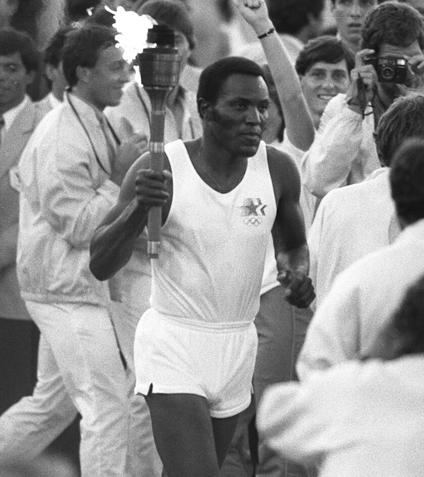 7/28/1984 – OLY LEGACY – Rafer Johnson runs around the track at the Los Angeles Coliseum on his