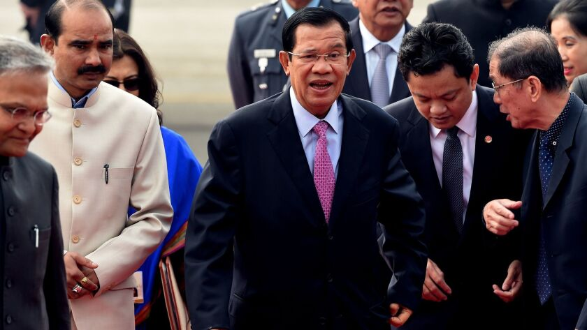 Cambodian Prime Minister Hun Sen, center, shown arriving for a meeting in New Delhi on Jan. 24, has established a reputation as a tough leader with a low tolerance for dissent.