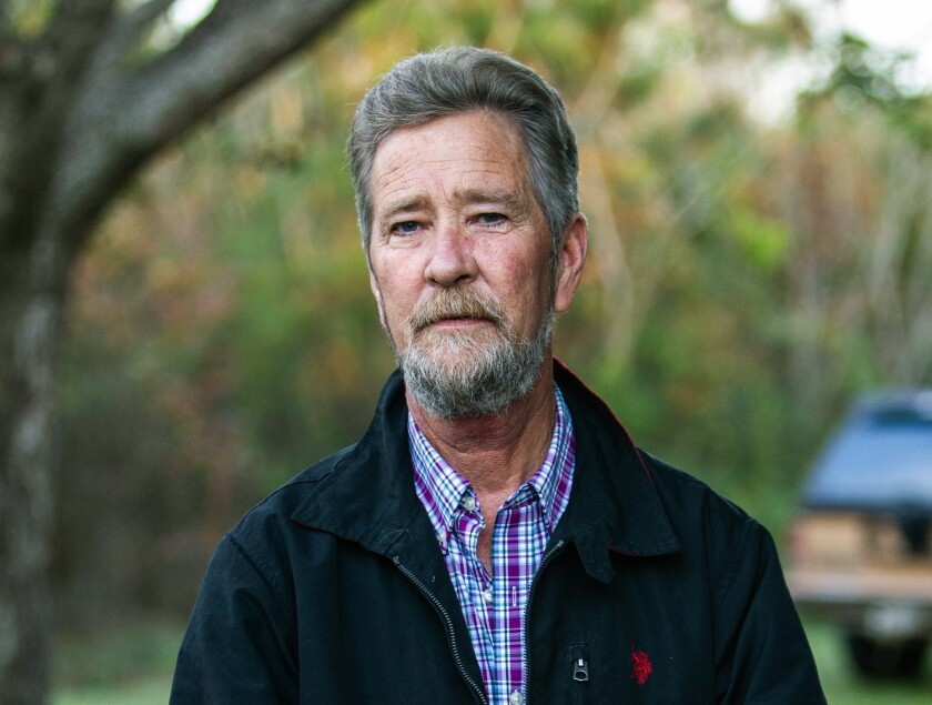 FILE - In this Dec. 5, 2018 file photo, Leslie McCrae Dowless Jr. poses for a portrait outside of his home in Bladenboro, N.C. The key figure in a North Carolina investigation into ballot fraud in a 2018 congressional race pleaded guilty on Monday to federal charges he unlawfully accepted Social Security benefits when concealing other money he earned. Dowless Jr., entered the plea before U.S. District Judge Terrence Boyle for theft of government property and Social Security fraud, according to court records. Dowless' trial had been scheduled to begin Monday, June 21, 2021. (Travis Long/The News & Observer via AP, File)