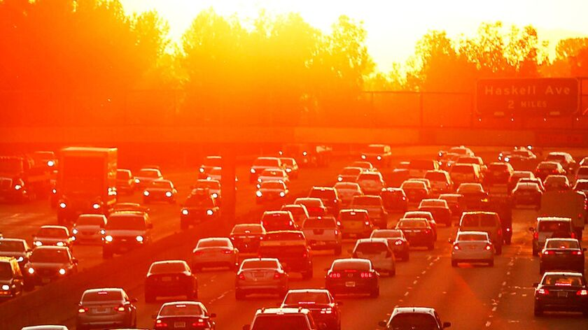 Traffic on the 101 Freeway backs up on March 27, 2015, the second day of a heat wave. As 2016 closes, it is expected to beat 2015 for the hottest year in recorded history.