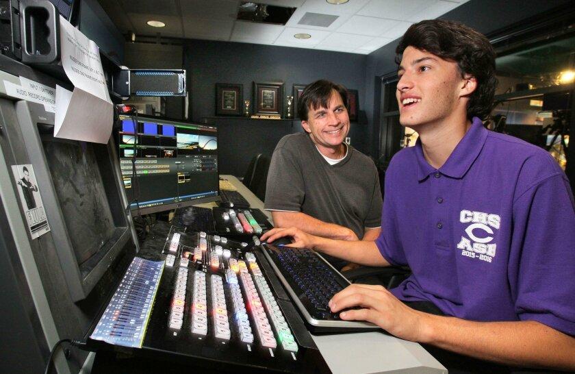 Carlsbad High School senior Joey Szalkiewicz works in the school's TV video broadcast control room. With him is his dad, Joe.