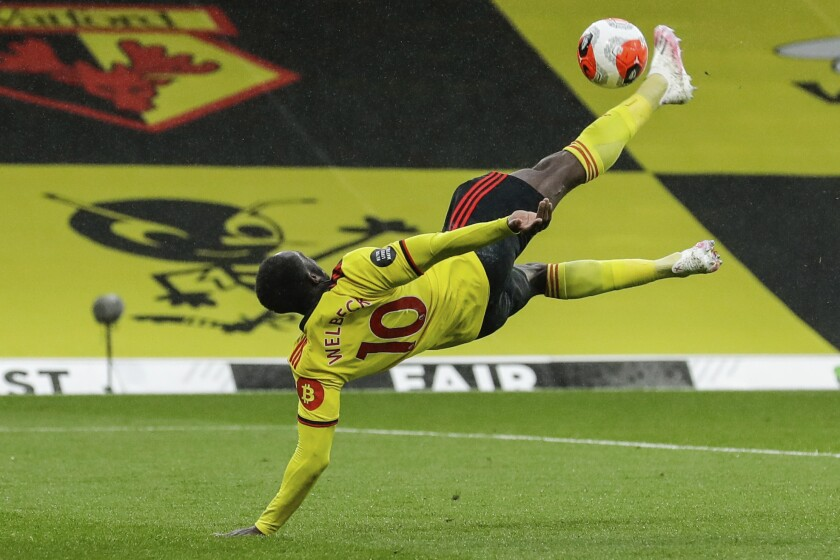 Walford's Danny Welbeck scores his team second goal during the English Premier League soccer match between Watford and Norwich City at the Vicarage Road Stadium in Watford, England, Tuesday, July 7, 2020. (AP Photo/Matt Dunham, Pool)