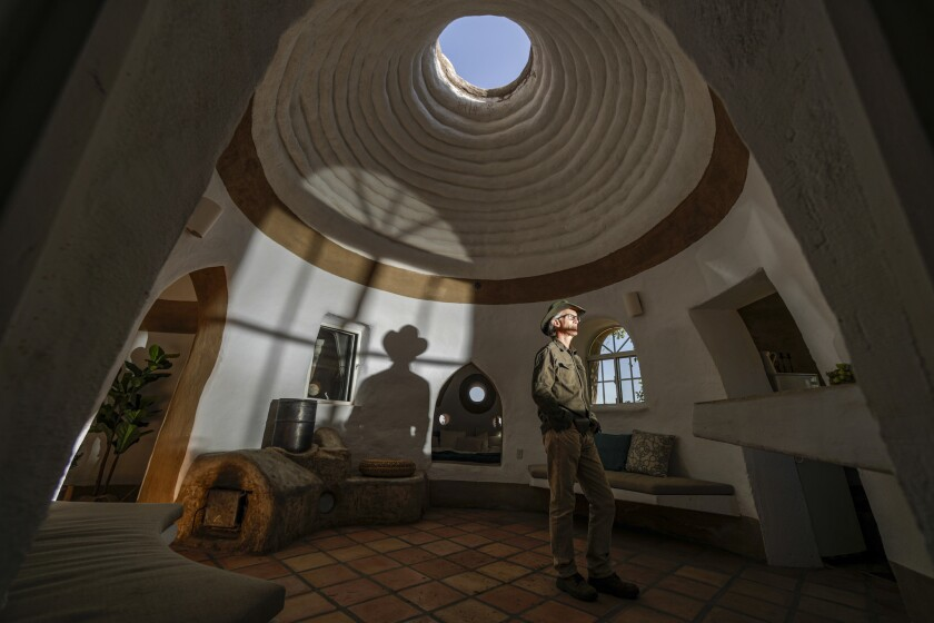 Site director Ian Lodge inside one of the fully staged CalEarth structures.
