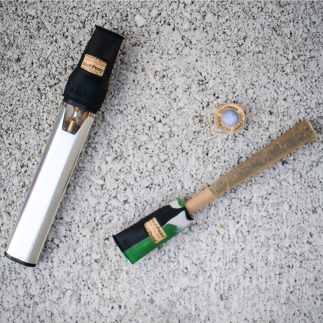 A joint and a vape pen with filters on them