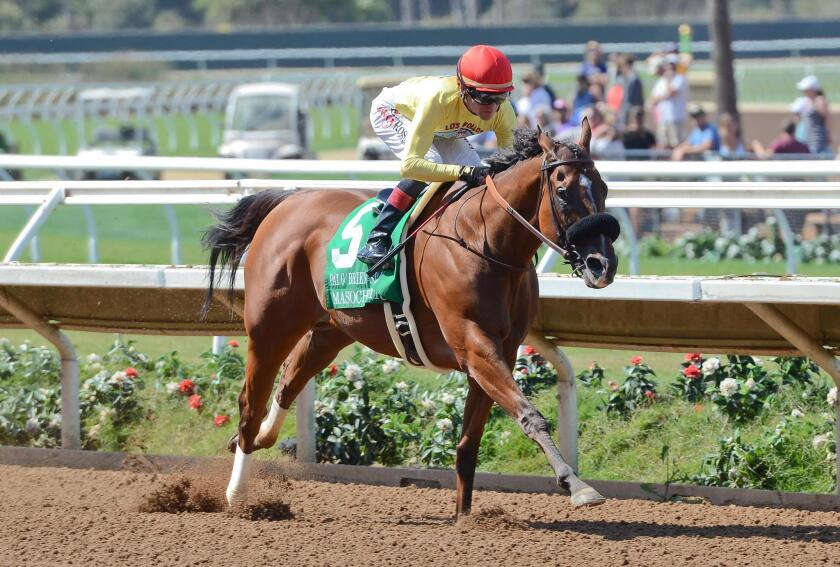 Jockey Tyler Baze racing to a win on Masochistic.